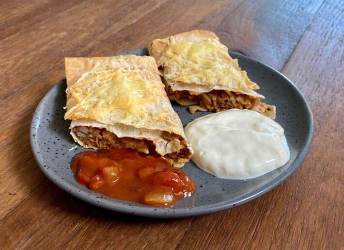 Pinto Bean Burrito Recipe - This pinto bean burrito recipe is a budget-friendly recipe that is nutritious, filling and delicious. The pinto bean burrito filling can be used in a variety of ways, but my favorite is baked in the oven and topped with salsa and Greek yogurt or sour cream.