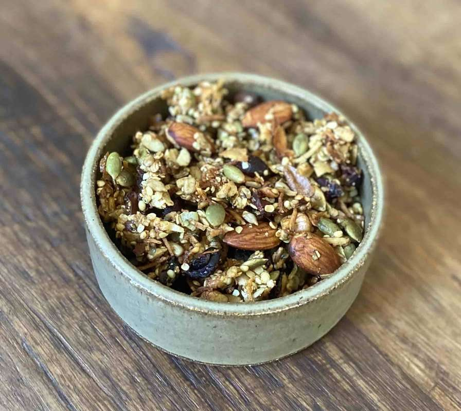 Paleo Granola Recipe - I was inspired to make a low carb granola recipe that was anti-inflammatory and grain-free thus this curcumin paleo granola recipe was born.  This paleo granola recipe is super easy to make, is filled with healthy nuts and seeds and naturally sweetened with cinnamon and honey.