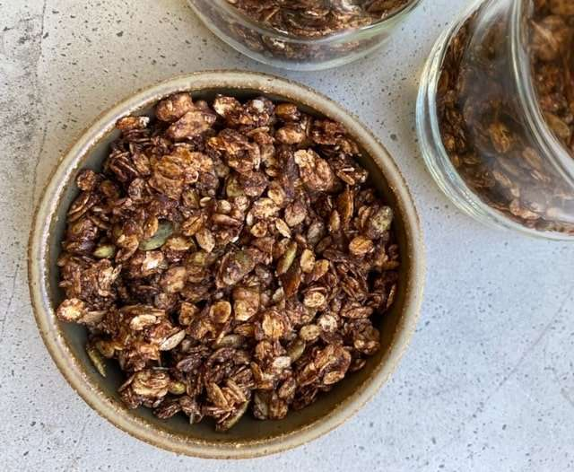 Chocolate Granola Recipe -  5 cups oats 1 cup sunflower seeds 1 cup chopped walnuts 1 cup pumpkin seeds ½ cup ground flax seeds ½ cup ground sesame seeds 1 cup raw cacao powder 1 cup rice malt syrup ½ a cup of coconut oil 2 tsp vanilla extract Pinch of sea salt