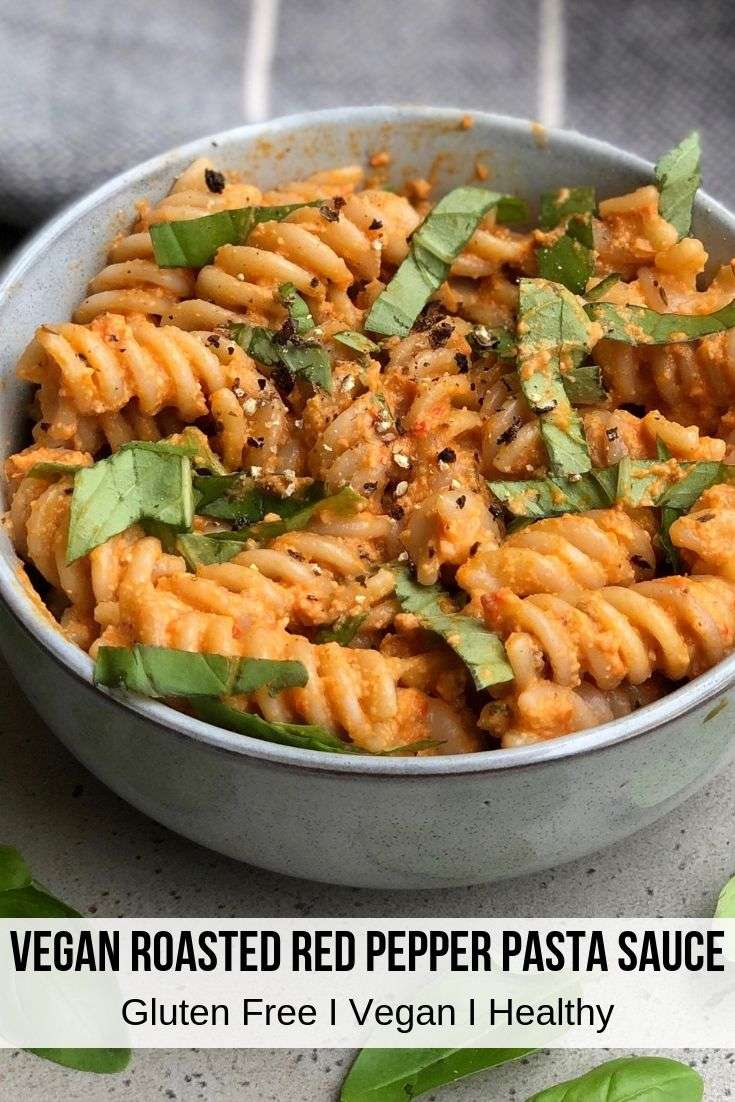This creamy vegan roasted red pepper pasta sauce is savory yet slightly sweet and the perfect comfort food to enjoy with gluten free pasta noodles or over zucchini noodles. The red pepper pasta sauce is served with basil that pairs perfectly with this healthy roasted red pepper pasta sauce. If your looking for creamy red pepper pasta sauce recipes this vegan pasta sauce is a must try. #healthydinners #pastasauce #glutenfree